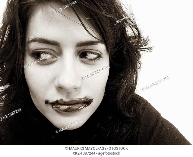 Portrait of woman with guilty expression and chocolate around her mouth