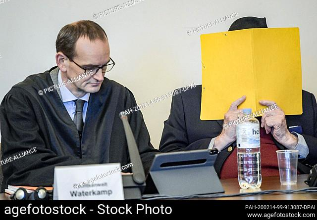 14 February 2020, Hamburg: The 93-year-old former SS guard (r), accused of aiding and abetting murder in 5230 cases, and his lawyer Stefan Waterkamp are waiting...