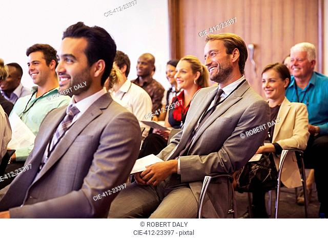 Business people attending meeting in conference room