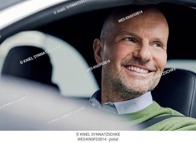 Portrait of smiling mature man in car