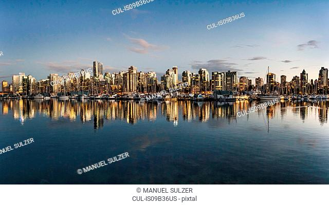 View of harbour and city skyline at dusk, Vancouver, Canada