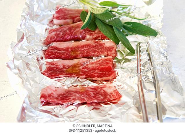 Wagyu with sage on aluminium foil
