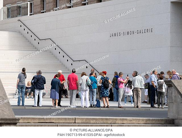 13 July 2019, Berlin: The first visitors are already waiting about an hour before the opening of the James Simon Gallery at the stairs to the entrance