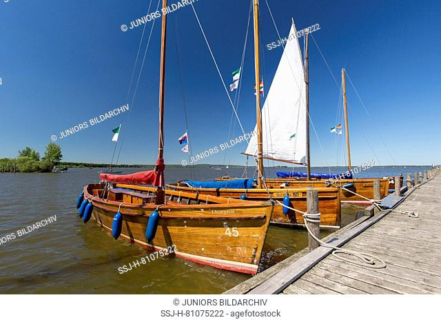 Historic sailing boats (Auswanderer) at a jetty on Lake Steinhude. Lower Saxony, Germany