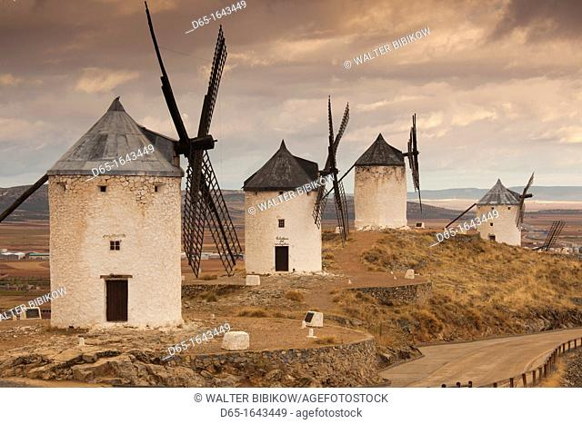 Spain, Castile-La Mancha Region, Toledo Province, La Mancha Area, Consuegra, antique La Mancha windmills, dawn