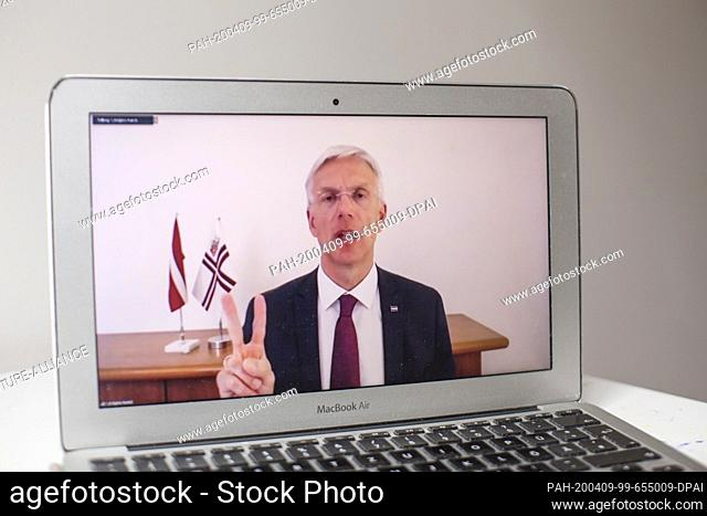 09 April 2020, Latvia, Riga: Krisjanis Karins, Prime Minister of Latvia, gesticulates at a virtual press conference, which is broadcast here by the Latvian...