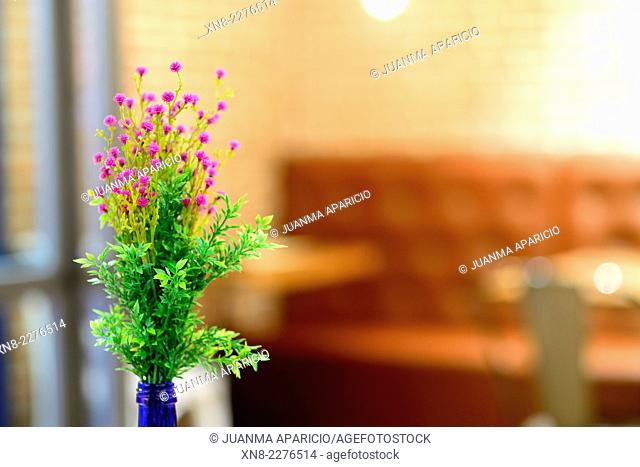 Floral details on the table of Restaurant
