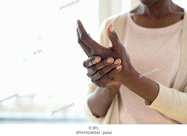 Mature woman with painful hand