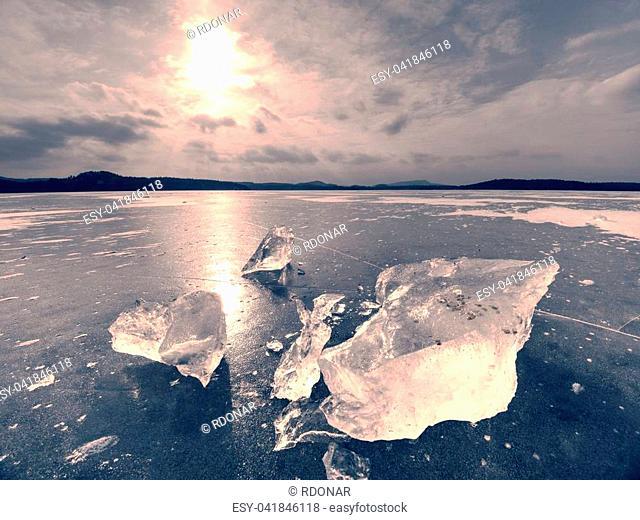 Broken glacier in the frozen bay. Beautiful winter background. Marvelous winter scene with marks of deep frost in wild landscape