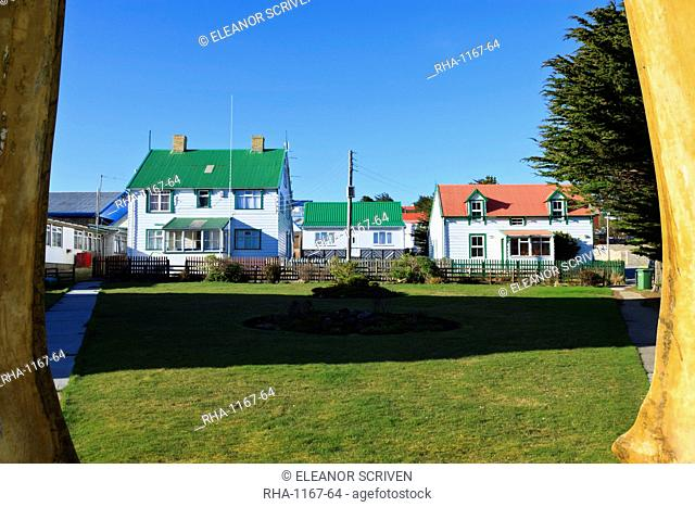 Christ Church cathedral green and houses, seen through whale bone arch, Stanley, East Falkland, Falkland Islands, South America