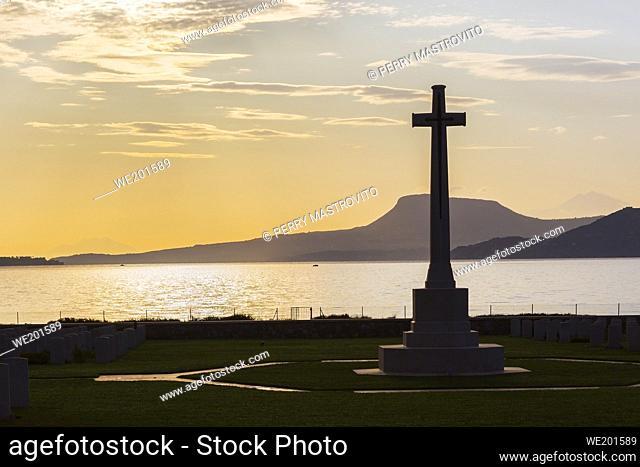Memorial cross, Souda Bay War Cemetery at sunrise, Chania region, Crete Island, Greece
