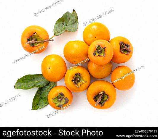 Japanese persimmons on a white background. Overhead shot