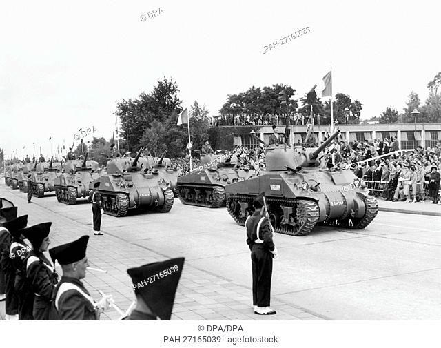 Tanks roll past the spectators in the headquarter of the French army in Berlin, called Quartier Napoleon, during a parade on the occasion of the French national...