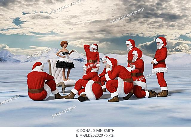 Girl standing on chair lecturing Santas