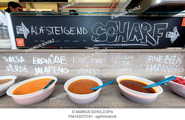 A range of spicy sauces for tacos at the Foodtruck Festival in Hamburg, Germany, 11 September 2015. PHOTO: MARKUS SCHOLZ/DPA | usage worldwide