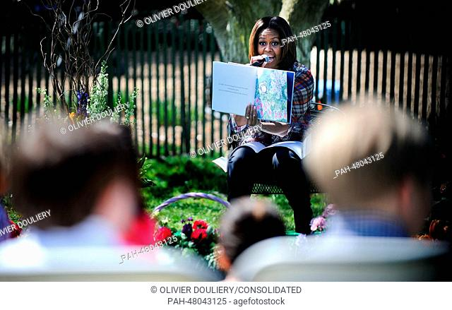 United States first lady Michelle Obama reads the story 'My Garden' to children during the annual White House Easter Egg Roll on the South Lawn of the White...