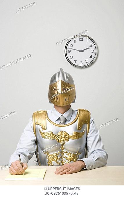 Businessman wearing gladiator armor