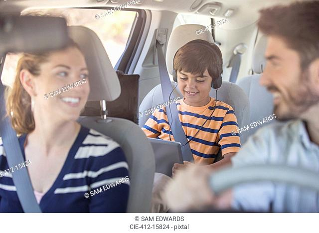 Happy family inside car