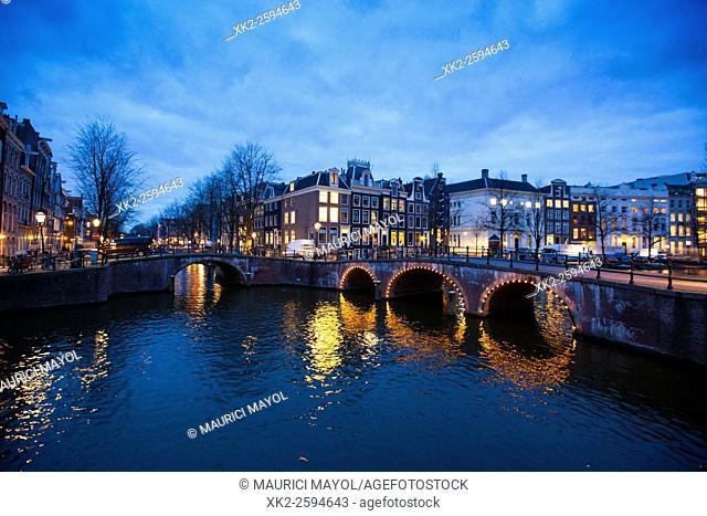 Keizergracht meets Leidsegracht bridge at dusk, Amsterdam, The Netherlands