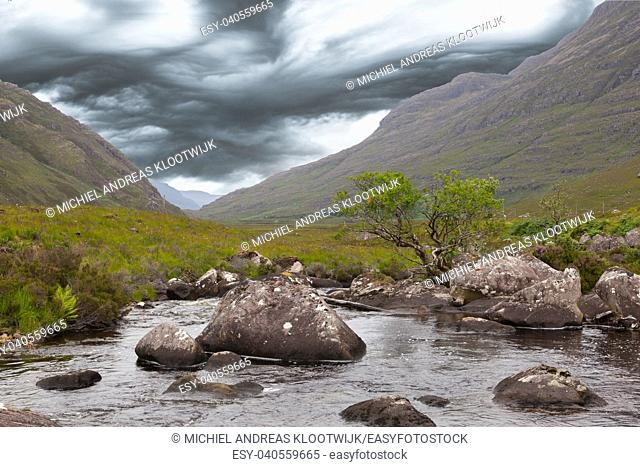 Landscape with waterfall in the mountains, Scotland