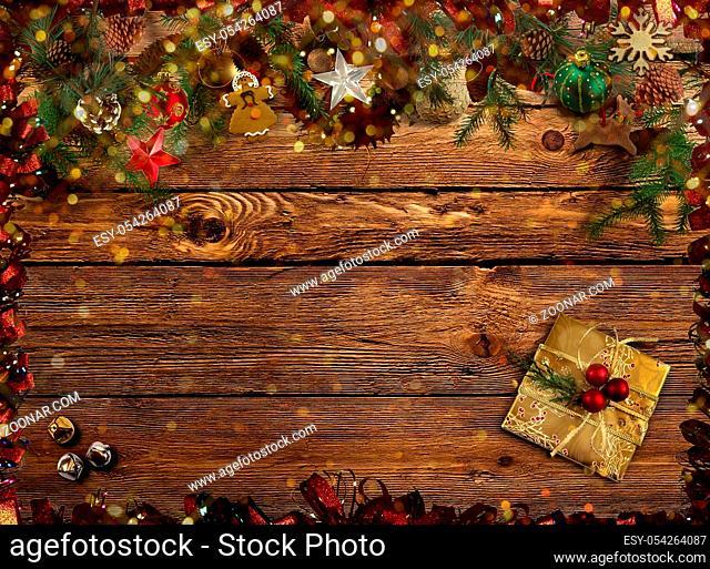 Symbols of Christmas: decorations, gifts, fir branches on wooden background