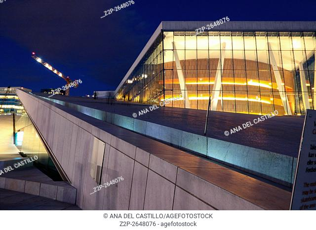 National Oslo Opera House shines at sunrise on March 19, 2016. Oslo Opera House was opened on April 12, 2008 in Oslo, Norway