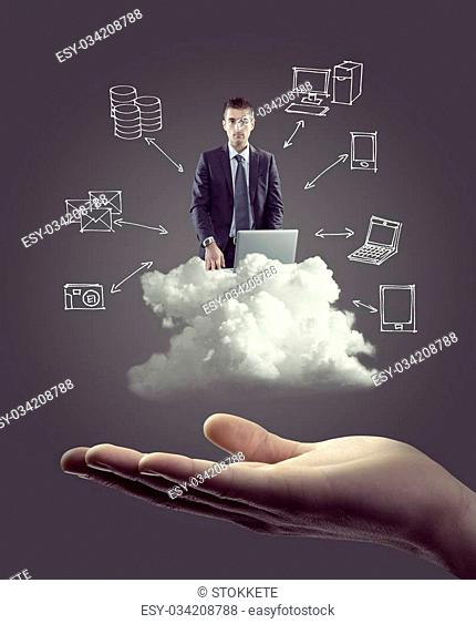 Businessman with laptop on cloud with hand drawn technology icons and hand