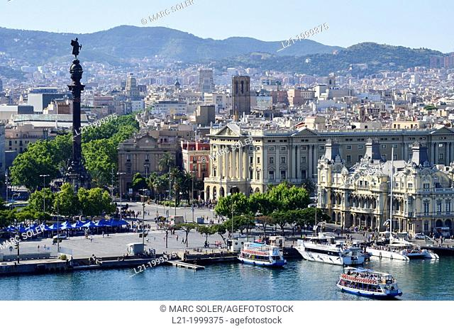 Port of Barcelona. Colom monument. Urban landscape of the city to the mountain of Collserola. Barcelona, Catalonia, Spain
