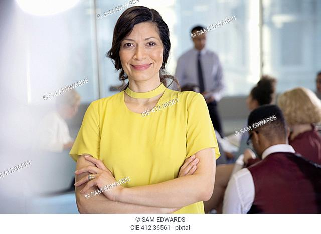 Portrait smiling, confident businesswoman in conference audience