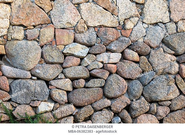 Background with conception - a wall made of sliced stones
