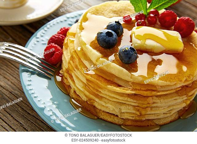 pancakes breakfast syrup coffee and orange juice with berries