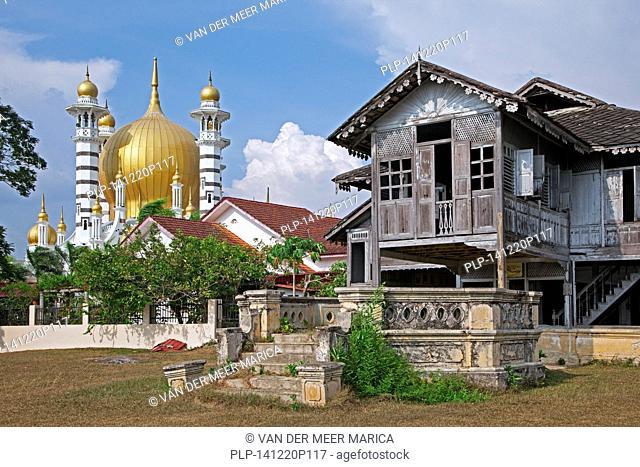 Ubudiah Mosque / Masjid Ubudiah and old traditional Malaysian wooden house on pillars in Kuala Kangsar, Perak, Malaysia