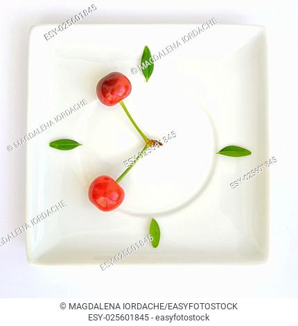 Natural clock concept from cherry fruit
