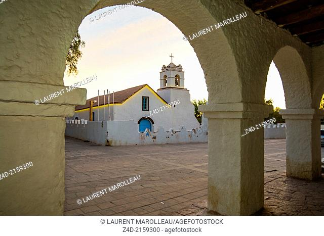 View of San Pedro church through doorway. The Church of San Pedro de Atacama. The church was built in the XVII century, underwent modifications in the XVIII...