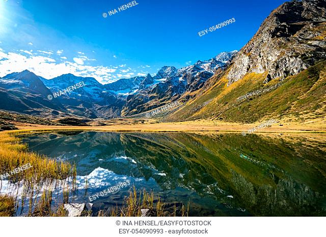 Panoramic view of the alpine Seebersee lake with the high rising mountains of the Texelgruppe in the background near the Timmelsjoch alpine street in South...