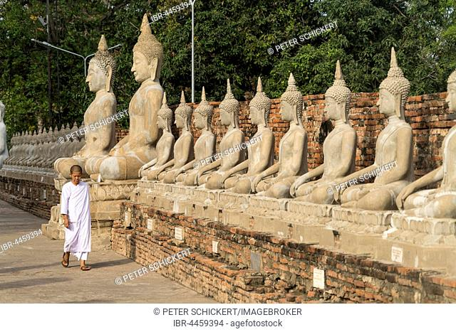 Row of Buddha statues, Wat Yai Chai Mongkhon, Ayutthaya Historical Park, Thailand