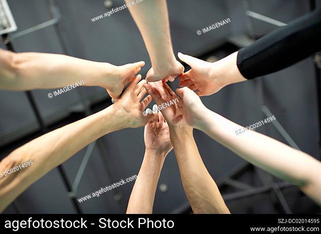 Hands putting together