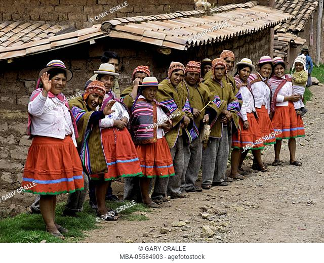 Quechua villagers of Misminay wave goodbye to visitors