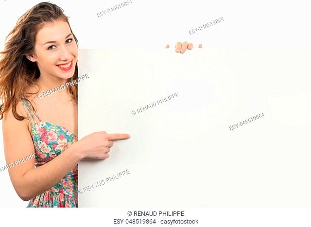 happy smiling young woman showing an empty blank signboard with copyspace
