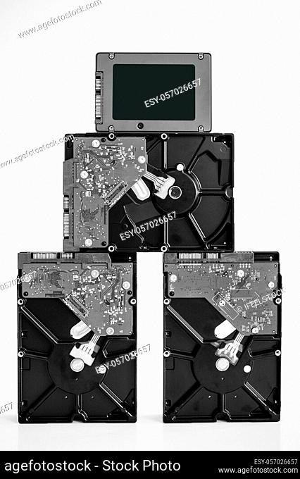 IT Pyramide with SSD Solid State Drive on top of the HDD Hard Disk drives black and white