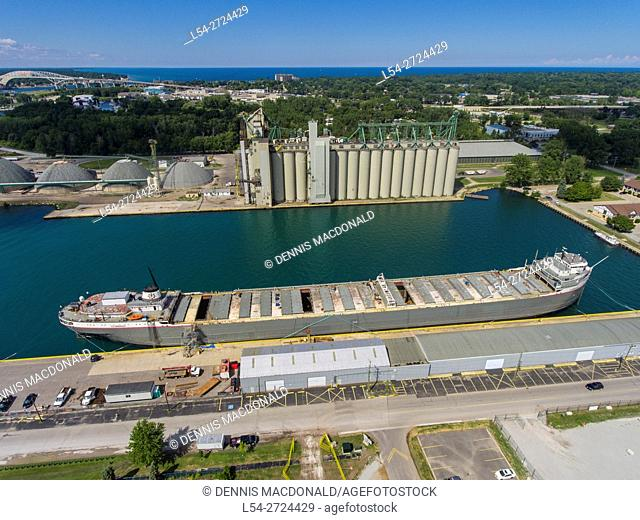 Great lakes grain elevator with freighter located at Sarnia Ontario Canada aerial view
