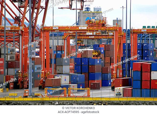 Cranes sorting shipping containers at Vancover port, British Columbia, Canada