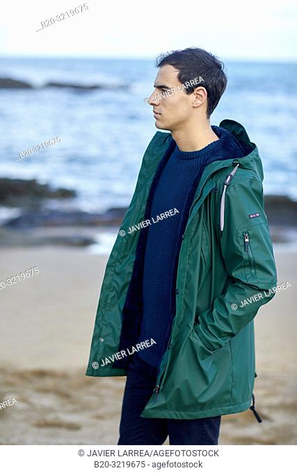 Young man, Beach, Mutriku, Gipuzkoa, Basque Country, Spain