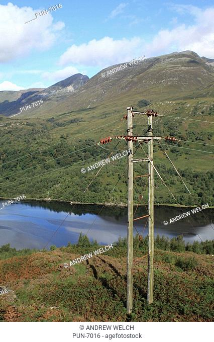 Electricity pylon on hillside above Kinlochleven at Loch Leven