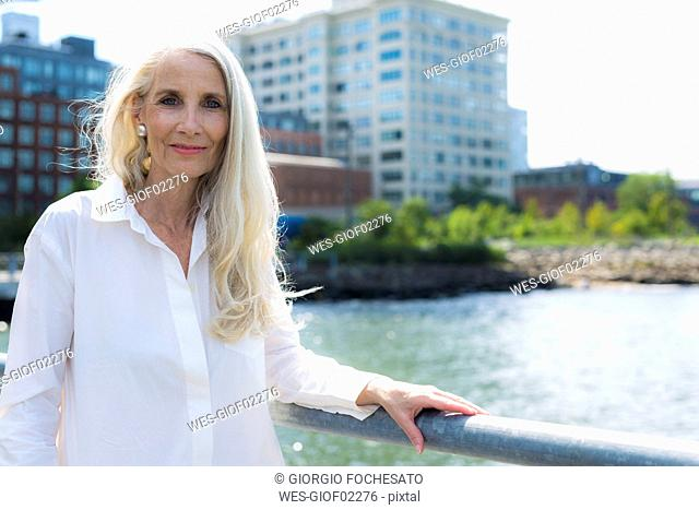 Portrait of smiling woman wearing white shirt blouse