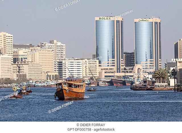 TRADITIONAL BOATS, ABRAS, SAILING IN THE DUBAI CREEK WITH THE ROLEX TOWERS IN THE BACKGROUND, DUBAI, UNITED ARAB EMIRATES, MIDDLE EAST