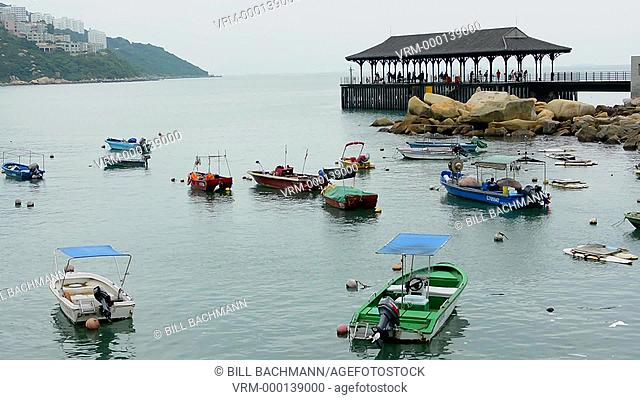 Hong Kong China Stanley village old shrimp fishing boats in harbour and wharf