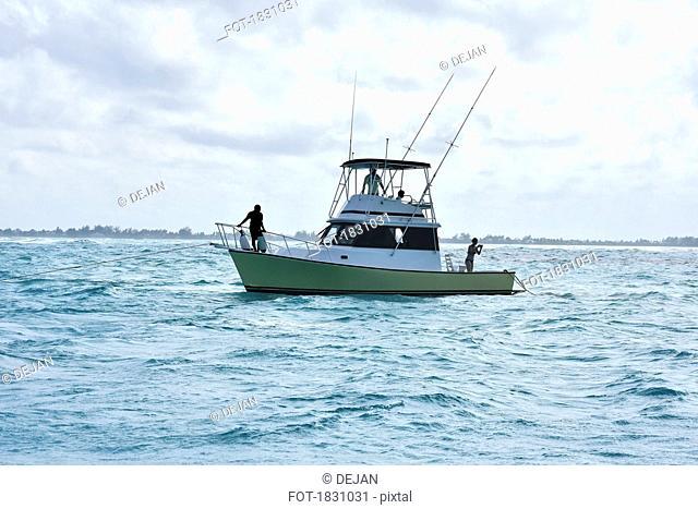 Fishing boat on choppy ocean, Grand Cayman Island, Cayman Islands