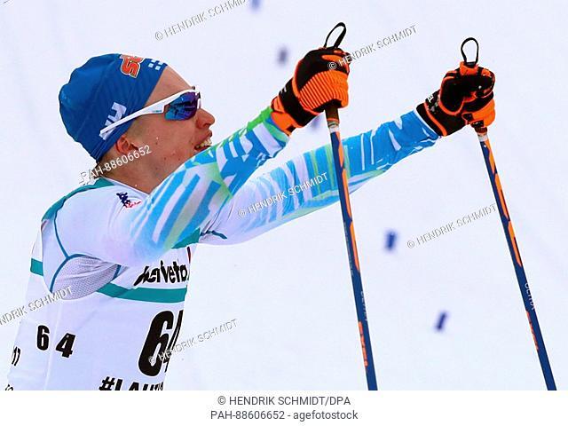 Finnish athlete Iivo Niskanen celebrates after taking gold at the Nordic Ski World Championship in Lahti, Finland, 28 February 2017