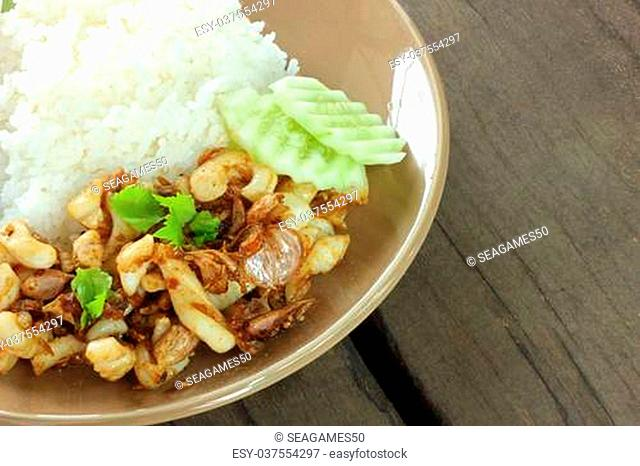 Fried squid with garlic rice and cucumber